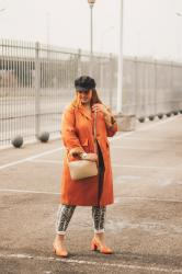 Orange trench; with Moda Florencia.